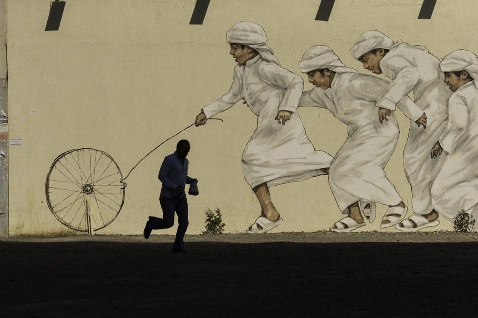Photo of بالصور | فن الجرافيتي ينتشر في شوارع الدولة