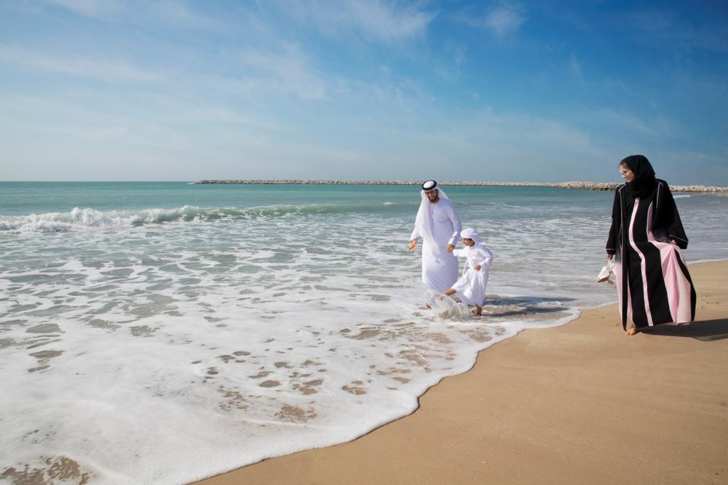 Arabic family on the beach in Ras Al Khaimah