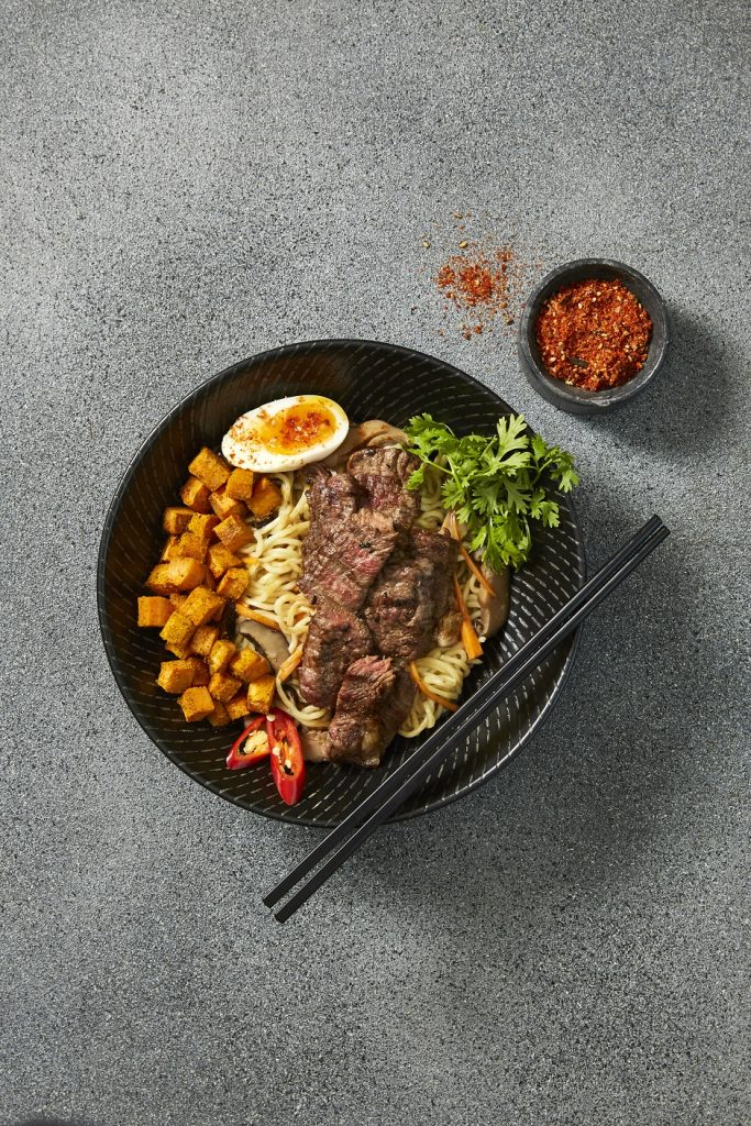 The Noodle House's caramel beef ramen is best enjoyed with chopsticks
