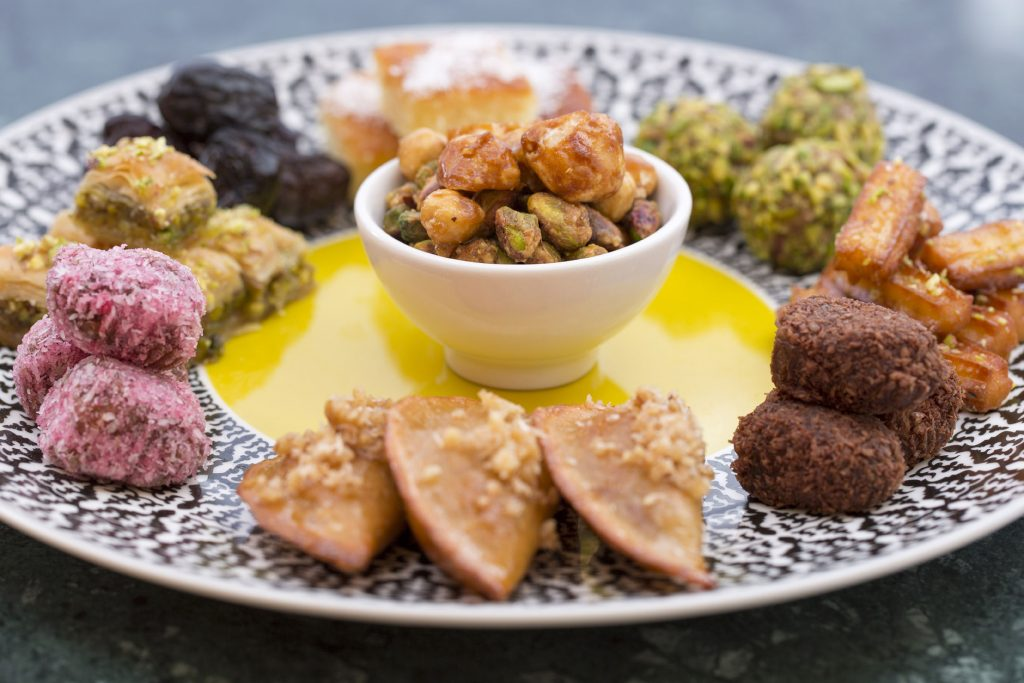 Selection of pastries and sweets – Emirati dates – Caramelized nuts – homemade Arabic sweets