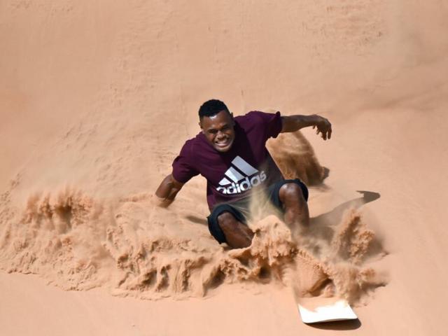 تجربة التزلج على الرمل Experience Sand Boarding
