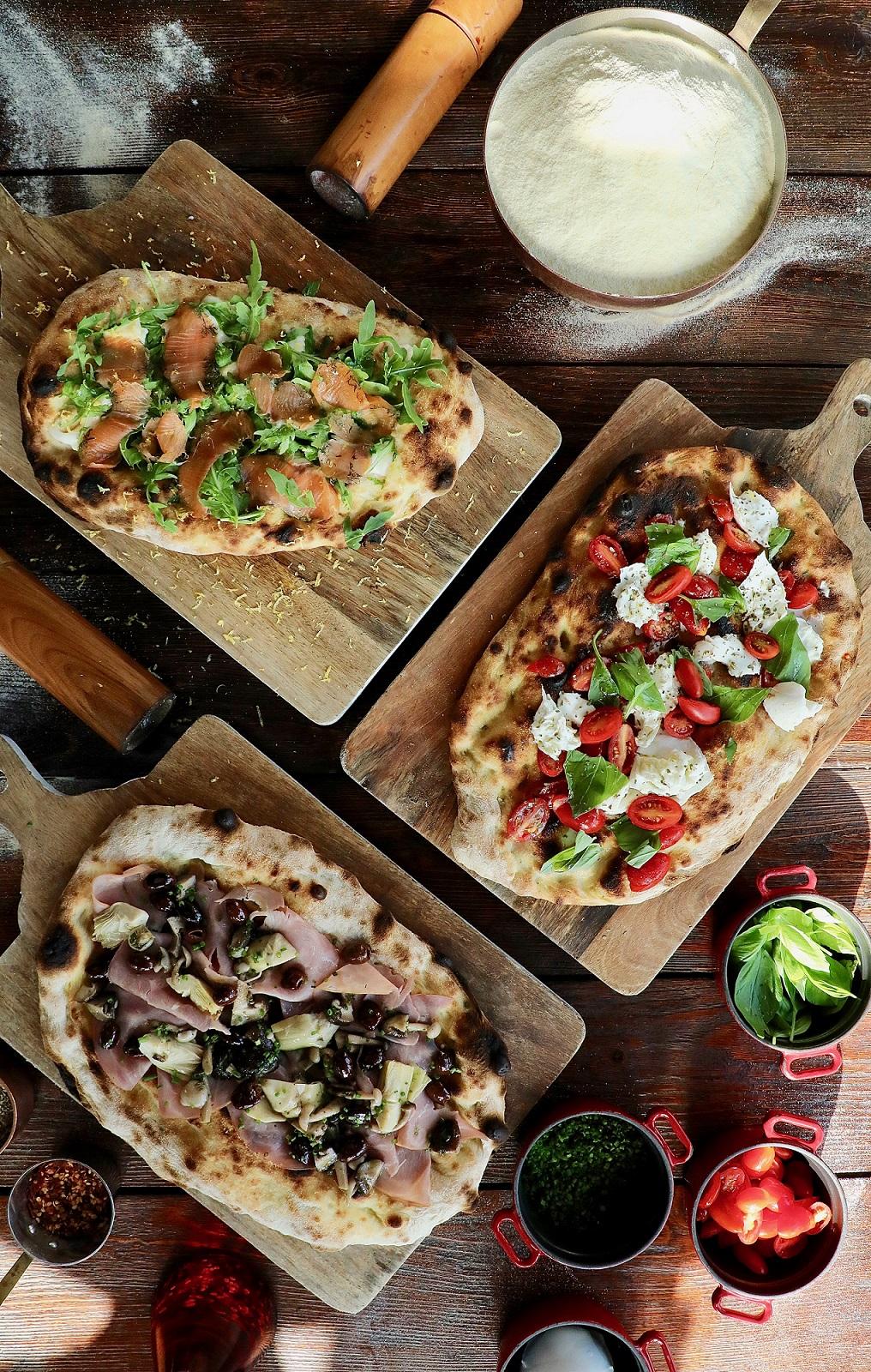 إستمتعوا بقائمة حصرية من بيتزا رومانا في مطعم تراتوريا توسكانا