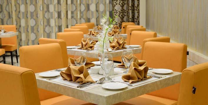 مقهى سينامون، فندق لاندمارك بريميير Landmark Premier Hotel