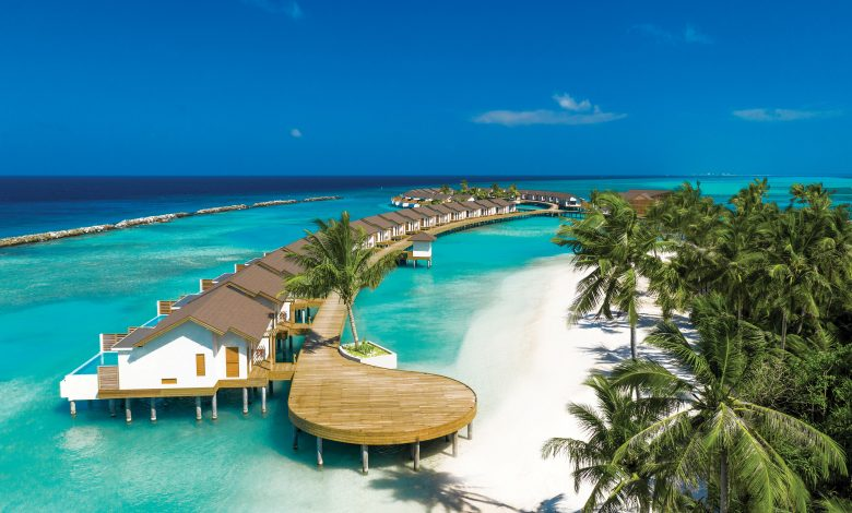 ATMOSPHERE KANIFUSHI MALDIVES – AERIAL VIEW – WATER VILLA JETTY 01