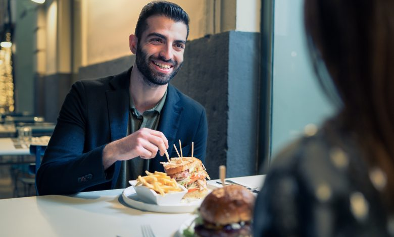 Portrait,Of,A,Bearded,Young,Man,Eating,Chips,And,Sandwiches